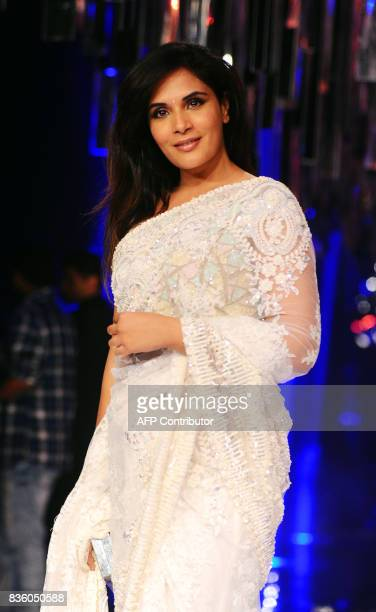 Indian Bollywood actress Richa Chadda poses for a photograph during the grand finale of Lakme Fashion Week Winter/Festive 2017 in Mumbai on August 20...