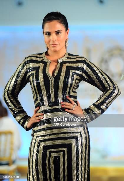 Indian Bollywood actress Richa Chadda showcases a creation during the Joya Fashion and Lifestyle Exhibition fashion show in Mumbai on late September...