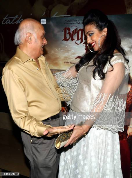 Indian Bollywood actress Rituparna Sengupta and producer Mukesh Bhatt attend a special screening of the Hindi film 'Begum Jaan' in Mumbai on April 13...