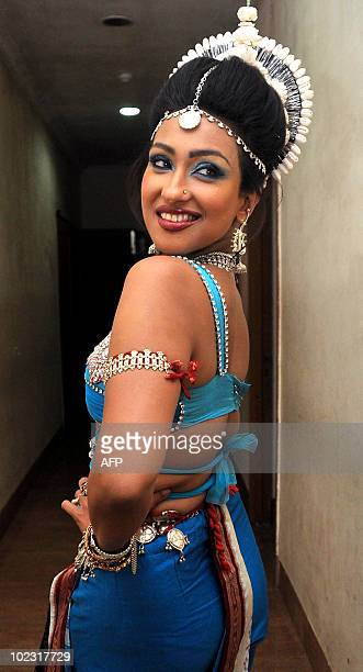 Indian bollywood actress Rituparna Sengupta poses during an event celebrating the 150th anniversary of Kabiguru Rabindranath Tagore in Mumbai on June...