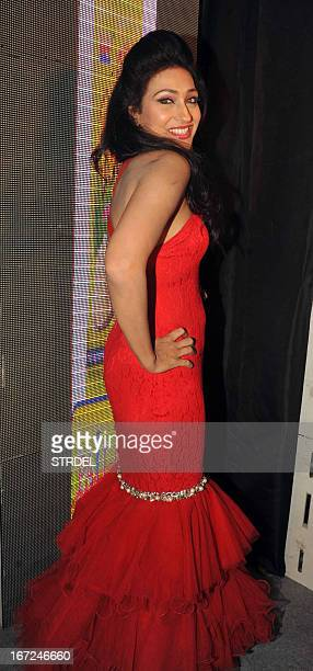 Indian Bollywood actress Rituparna Sengupta poses during the launch of a food product in Mumbai on April 22 2013 AFP PHOTO/STR