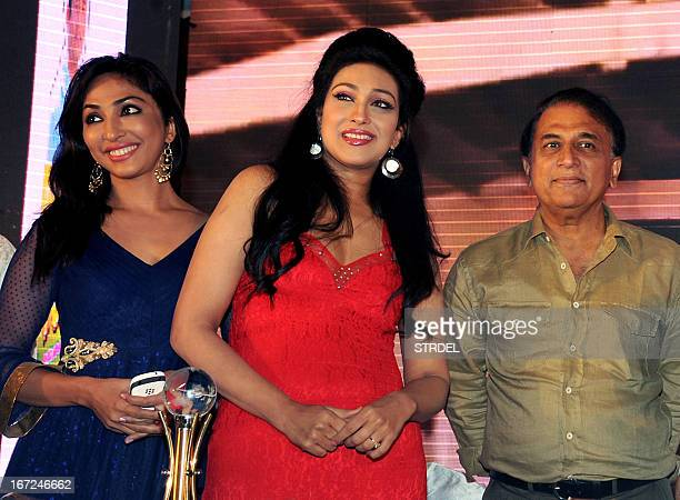 Indian Bollywood actress Rituparna Sengupta poses with actress Mouli Ganguly and former Indian cricketer Sunil Gavaskar during the launch of a food...