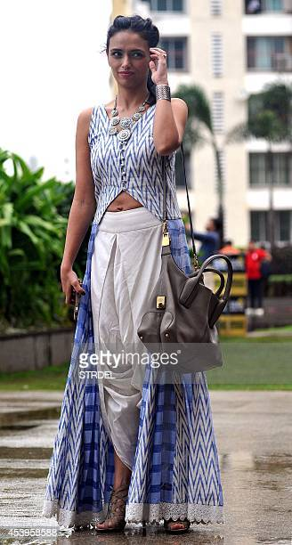 Indian Bollywood actress Roshani Chopra poses during the Lakme Fashion Week Winter/Festival 2014 in Mumbai on August 22 2014 AFP PHOTO/STR