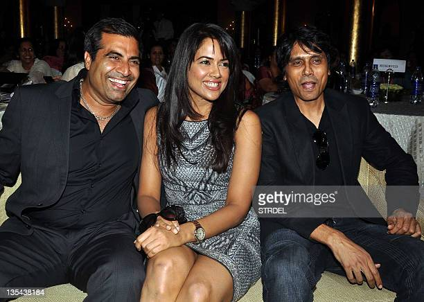 Indian Bollywood actress Sameera Reddy flanked by director Nagesh Kukunoor and producer Shailendra Singh pose during the Women's Empowerment Awards...