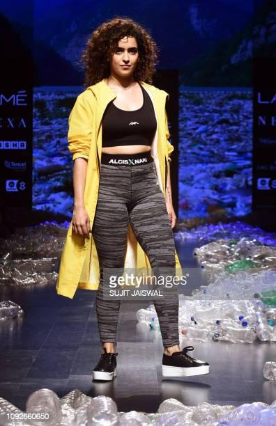 Indian Bollywood actress Sanya Malhotra showcases a creation by designer Narendra Kumar at the Lakmé Fashion Week Summer Resort 2019 in Mumbai on...