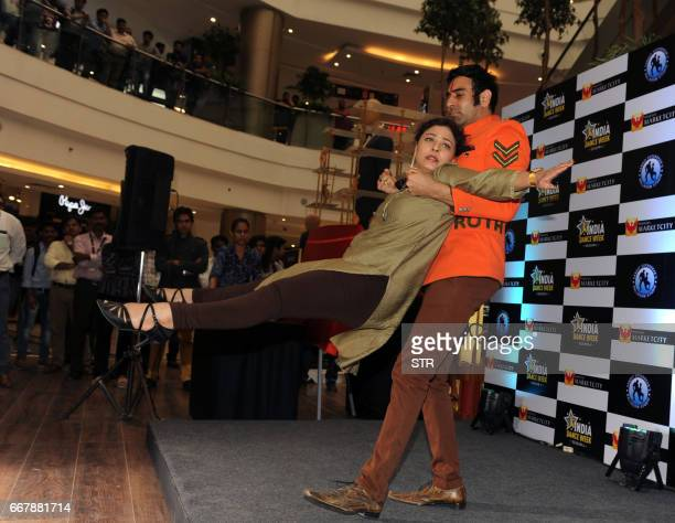 Indian Bollywood actress Sharbani Mukherjee performs a routine with choreographer Sandip Soparkarr during the unveiling of 'Dance Week season four in...