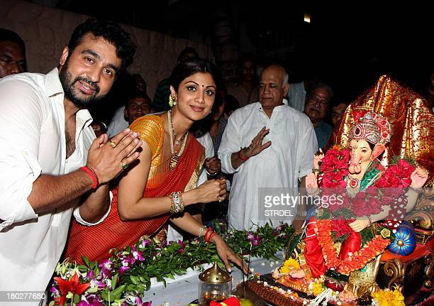 Indian Bollywood actress Shilpa Shetty and her husband Raj Kundra pose for a photo near an idol of the elephantheaded Hindu God Lord Ganesh during...