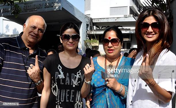 Indian Bollywood actress Shilpa Shetty her sister Samita Shetty and their parents pose for a photograph after voting at a polling station in Mumbai...