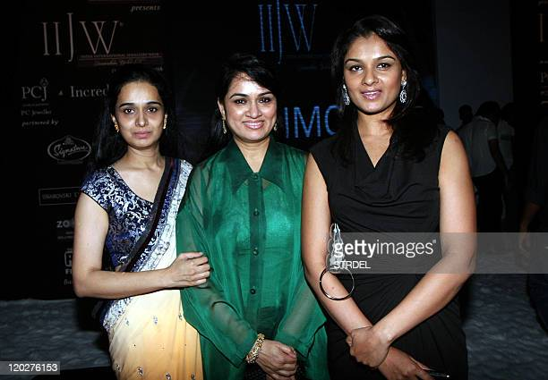 Indian Bollywood actress Shivangi Kapoor poses with sisters Padmini Kolhapure and Tejaswini Kolhapure during the second edition of The Indian...