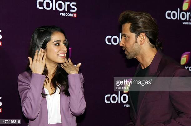 Indian Bollywood actress Shraddha Kapoor gesture as she speaks with actor Hrithik Roshan as they attend the Colors Annual Party in Mumbai late April...