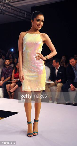 Indian Bollywood actress Shraddha Kapoor showcases a creation by designer Miss Bennett on the second day of the Lakme Fashion Week summer/resort 2015...