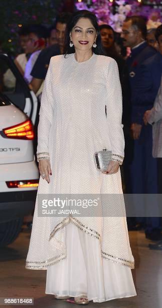 Indian Bollywood actress Simi Garewal poses for a picture as she attends the preengagement party of India's richest man and Reliance Industries...