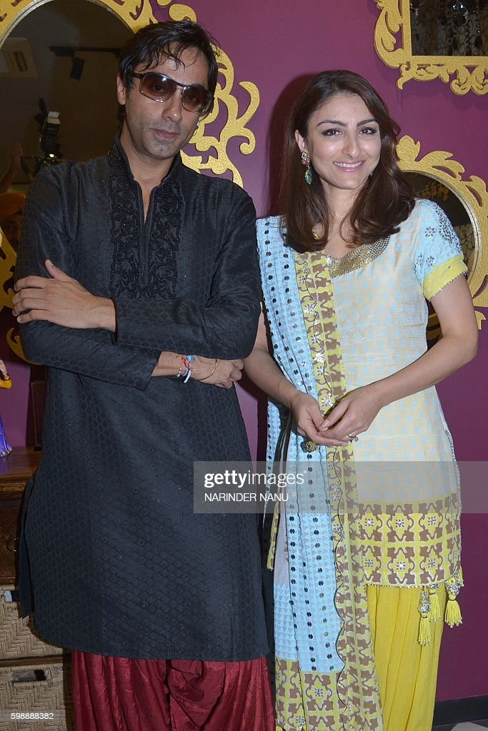 Indian Bollywood actress Soha Ali Khan poses with producer Harry Sachdeva during a promotional event for the forthcoming Bollywood film `31st...