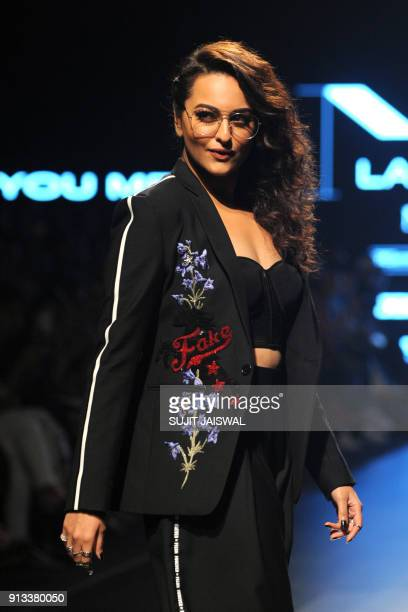 Indian Bollywood actress Sonakshi Sinha showcases a creation by designer Falguni Shane Peacock at the Lakmé Fashion Week Summer Resort 2018 in Mumbai...