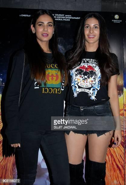 Indian Bollywood actress Sonal Chauhan and Kiara Advani attend the special screening of upcoming comedy Hindi film 'Kaalakaandi' in Mumbai on January...
