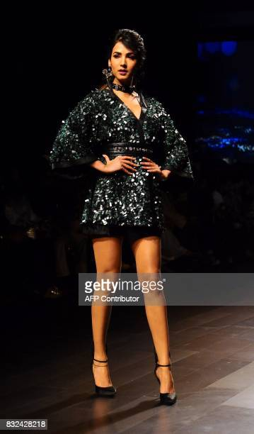 Indian Bollywood actress Sonal Chauhan showcases a creation by designer Sonal Verma at Lakme Fashion Week Winter/Festive 2017 in Mumbai on August 16...