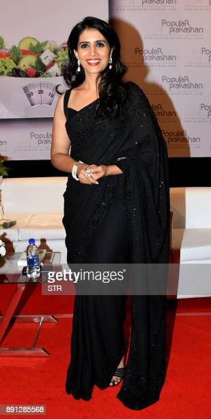 Indian Bollywood actress Sonali Kulkarni poses for a photograph during a promotional event in Mumbai on late December 12 2017 / AFP PHOTO / STR