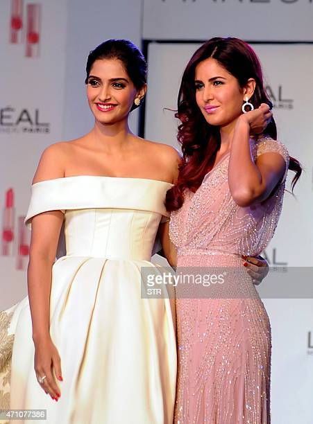 Indian Bollywood actress Sonam Kapoor and Katrina Kaif unveil L'Oreal Paris for its new Cannes collection in Mumbai on April 25 2015 AFP PHOTO