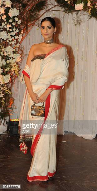 Indian Bollywood actress Sonam Kapoor poses as she attends a reception after the wedding of fellow thespians Bipasha Basu and Karan Singh Grover in...