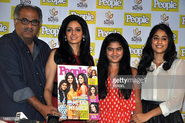 Indian Bollywood actress Sridevi with husband Boney Kapoor daughters Khushi and Jhanvi Kapoor pose during the unveiling of the latest Indian edition...