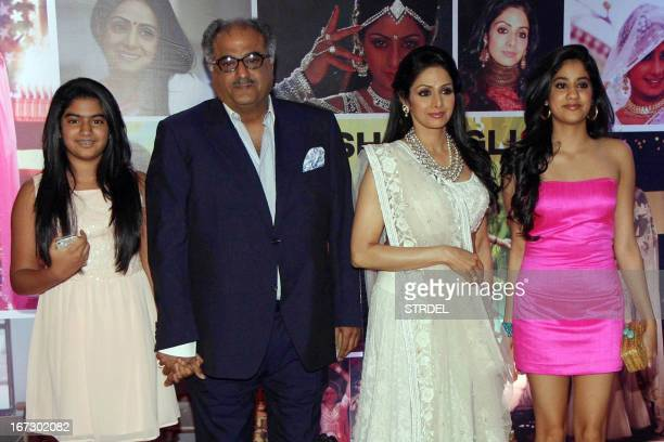 Indian Bollywood actress Sridevi with husband Boney Kapoor pose with their daughters Jhanvi and Kushi during a promotional event in Mumbai on April...