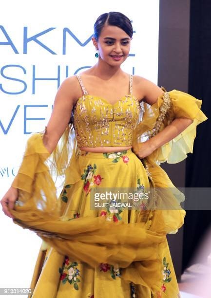 Indian Bollywood actress Surveen Chawla poses for a photograph at Lakmé Fashion Week Summer Resort 2018 in Mumbai on February 2 2018 / AFP PHOTO /...