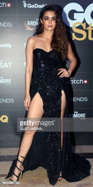 Indian Bollywood actress Surveen Chawla poses for a picture during the 'GQ Style Awards 2018' ceremony in Mumbai late on March 31 2018 / AFP PHOTO /...