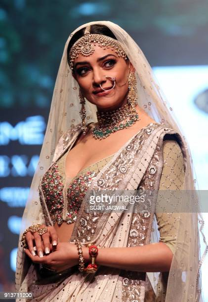 Indian Bollywood actress Sushmita Sen showcases a creation by designer Kotwara at the Lakmé Fashion Week Summer Resort 2018 in Mumbai on February 3...