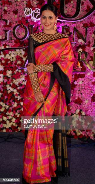 Indian Bollywood actress Taapsee Pannu poses for a photograph during a promotional event in Mumbai on late December 10 2017 / AFP PHOTO / Sujit...