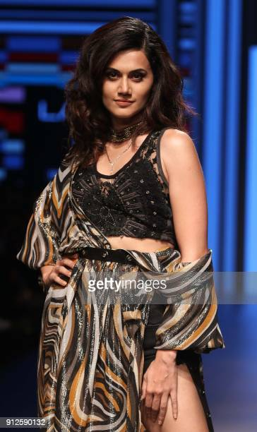 Indian Bollywood actress Taapsee Pannu showcases a creation by designer Ritu Kumar at the Lakmé Fashion Week Summer Resort 2018 in Mumbai on January...