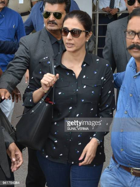 Indian Bollywood actress Tabassum Fatima Hashmi known as Tabu arrives at the airport in Jodhpur on April 4 2018 ahead of a verdict in the longrunning...
