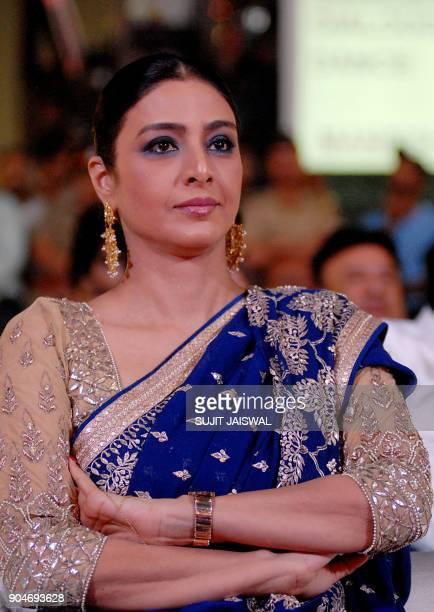 Indian Bollywood actress Tabbu looks on during the 'Umang Mumbai Police Show 2018' in Mumbai on late January 13 2018 / AFP PHOTO / Sujit Jaiswal