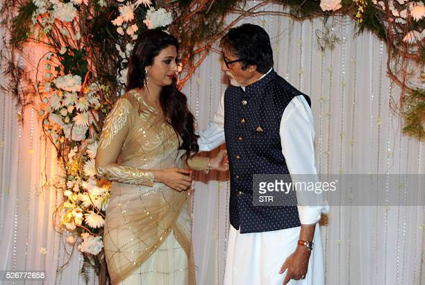 Indian Bollywood actress Tabu and actor Amitabh Bachchan pose as they attend a reception after the wedding of fellow thespians Bipasha Basu and Karan...