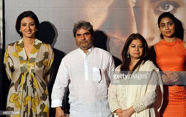 Indian Bollywood actress Tabu music composed by Vishal Bhardwaj with his wife singer Rekha Bhardwaj and actress Shriya Saran pose during the poster...