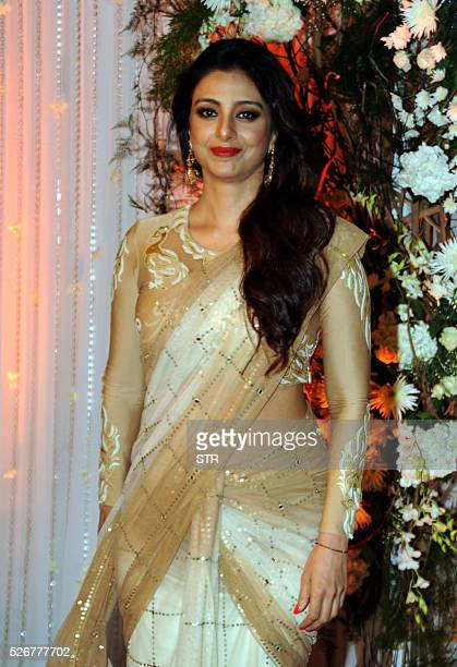Indian Bollywood actress Tabu poses as she attends a reception after the wedding of fellow thespians Bipasha Basu and Karan Singh Grover in Mumbai...