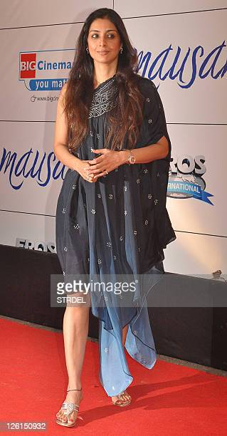Indian Bollywood actress Tabu poses as she attends the premiere for the Hindi film Mausam in Mumbai late September 22 2011 AFP PHOTO/STR