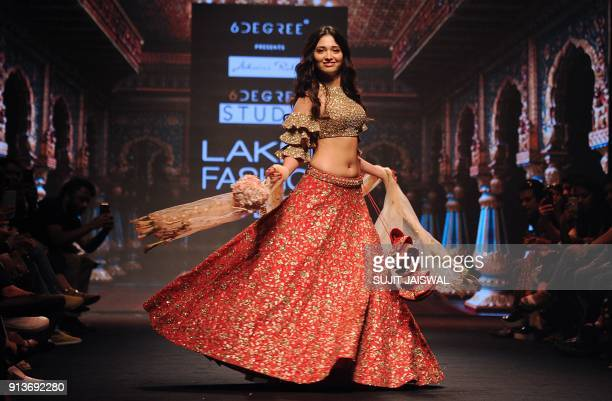 Indian Bollywood actress Tamannaah Bhatia showcases a creation by designer Ashwini Reddy at the Lakmé Fashion Week Summer Resort 2018 in Mumbai on...