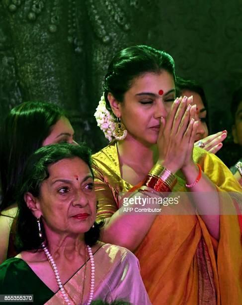 Indian Bollywood actress Tanuja Mukherjee and Kajol Devgn attend celebrations for the Hindu Durga Puja festival in Mumbai on September 2017 / AFP...