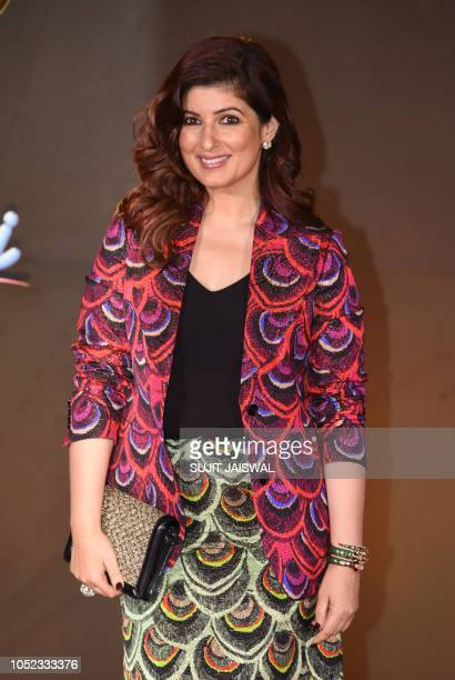 Indian Bollywood actress Twinkle Khanna poses for a picture as they attend an event celebrating the 20th anniversary of the Hindi film 'Kuch Kuch...