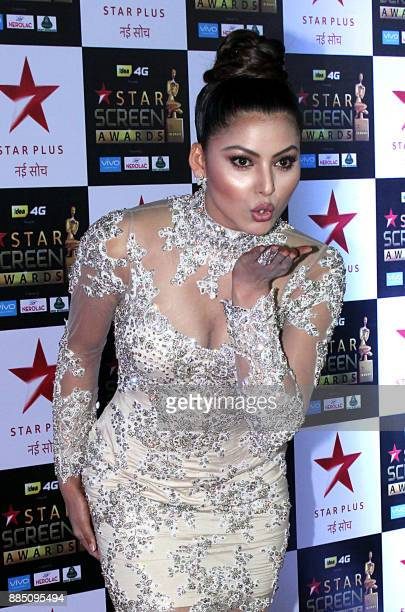 Indian Bollywood actress Urvashi Rautela attends the Star Screen Awards 2017 ceremony in Mumbai on December 3 2017 / AFP PHOTO /