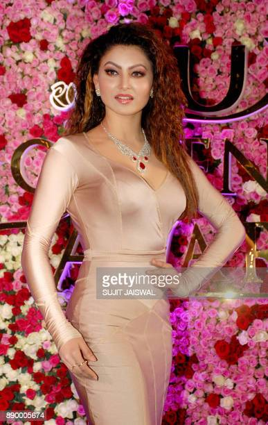 Indian Bollywood actress Urvashi Rautela poses for a photograph during a promotional event in Mumbai on late December 10 2017 / AFP PHOTO / Sujit...