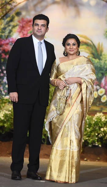 Indian Bollywood Actress Vidya Balan And Her Husband Siddharth Roy Kapur Pose For A Picture During