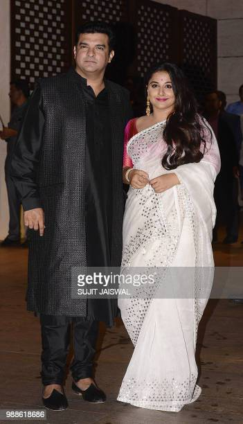Indian Bollywood actress Vidya Balan and husband and film producer Siddharth Roy Kapur pose for a picture as they attend the preengagement party of...