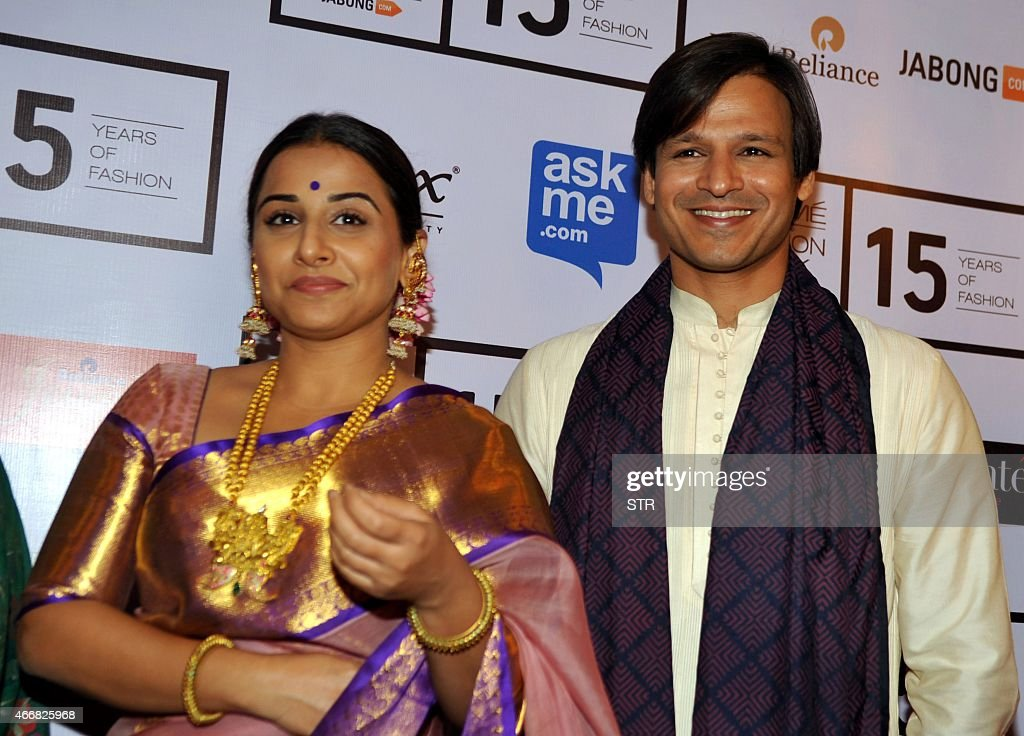 Indian Bollywood actress Vidya Balan (L) and Vivek Oberoi attend the second day of the Lakme Fashion Week (LFW) summer/resort 2015 in Mumbai on March 19, 2015.