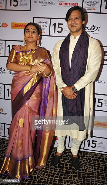 Indian Bollywood actress Vidya Balan and Vivek Oberoi attend the second day of the Lakme Fashion Week summer/resort 2015 in Mumbai on March 19 2015...