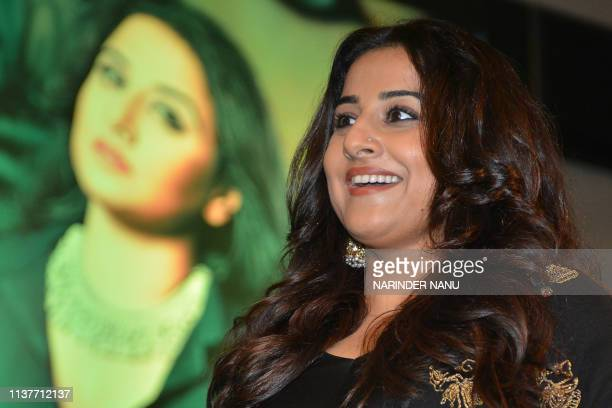 Indian Bollywood actress Vidya Balan looks on during an event organised by the Federation of Indian Chambers of Commerce and Industry Ladies...