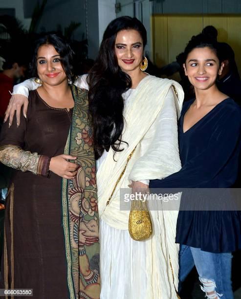 Indian Bollywood actress Vidya Balan , Rekha and Alia Bhatt attend the screening of Hindi film Begum Jaan in Mumbai on April 7, 2017. / AFP PHOTO / -