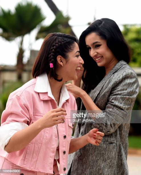 Indian Bollywood actress Yami Gautam and Shraddha Kapoor interact during the promotion of the upcoming drama Hindi film 'Batti Gul Meter Chalu' in...