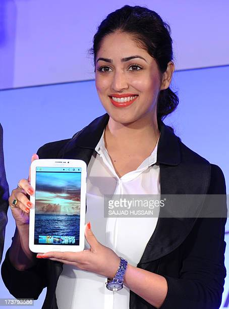 Indian Bollywood actress Yami Gautam poses displaying the newly launched Galaxy Tab 3 series at a function in New Delhi on July 18 2013 AFP PHOTO/...