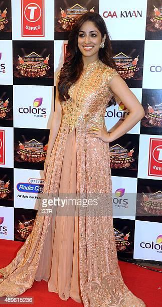 Indian Bollywood actress Yami Gautam poses during the 'Suron Ke Rang Color ke Sang Salaam Shri Gulshan Kumar' musical concert in fond memory of the...